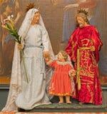 Bruselas - la familia santa en el vestido en la iglesia Eglise de St Jean y St. Etienne Minimes aux. Imágenes de archivo libres de regalías