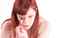 Brush. Woman putting on her eye makeup in preparation for a night out Royalty Free Stock Photos