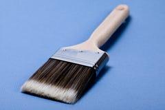 Brush. One brush on blue background Stock Photography