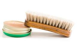 Brush. Shoe polish and brush on a white royalty free stock images