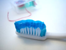 Brush?. Tooth brush with floss out of focus royalty free stock photos