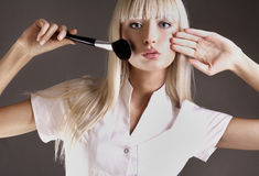 Brush. Attractive blonde with face powder brush Royalty Free Stock Images