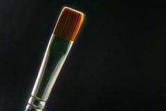 Brush against light. Artist's Brush stock image