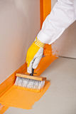 Brush applied waterproofing. Builder with brush applied waterproofing on the floor of the bathroom before tilling Royalty Free Stock Photography