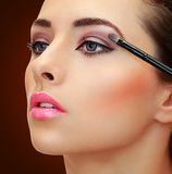 Brush applying eye shadows on Royalty Free Stock Photography