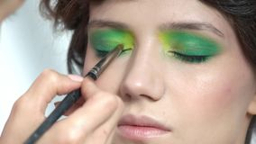 Brush applying eyeshadow. stock footage