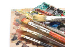 Brush and art palette with paints Stock Photography