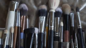 Brush background a makeup brush is a tool with bristles used for the application of makeup or face painting. stock video footage