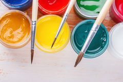 Brush on the bank with a paint gouache Royalty Free Stock Photography