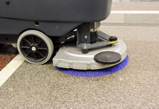 Brush in the battery scrubber-dryer in the metro Stock Image