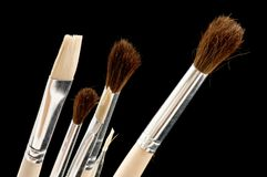 Brush on black Stock Photography