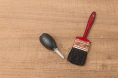 Brush and Black Silicone blower for camera and lenses rubber pear Stock Photography