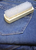 Brush on blue jeans Stock Photo