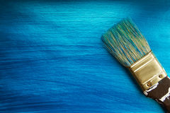 A brush on a blue nacreous color painted background. royalty free stock images