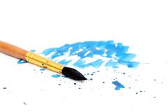 Brush with blue paint stroke Stock Photo