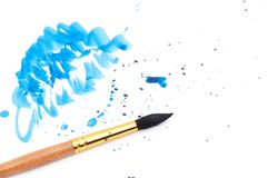 Brush with blue paint stroke. And stick, isolated on white Stock Photos