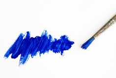 Brush and blue painting. Old paint brush with blue scratch Stock Photo