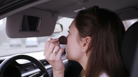 Brush for blush. Violations of the law by a female driver in transport. Glamour and beauty