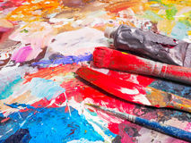 Brush and bright oil-paint palette for background Stock Photos
