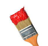 Brush with bright red paint. Isolated on white background royalty free stock images