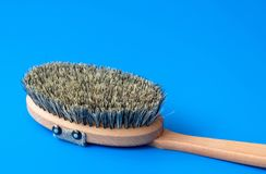 Brush with bristles made of horsehair on a blue background. Brush with bristles made of horsehair on blue background stock photos