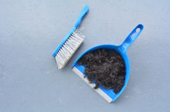 Brush broom with dustpan cleaning human hair Stock Image