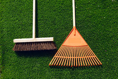 Brush and broom on a green grass Royalty Free Stock Images