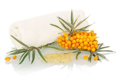Brush buckthorn, bath salt and towel isolated on white. Background Stock Images