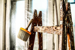 Brush - building industry - painting tools. Renovation of old buildings. ladder and painting brush Stock Photos