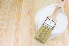 Brush with can of paint on wooden background Stock Photos