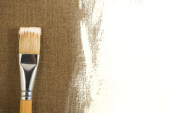 Brush and canvas Stock Images