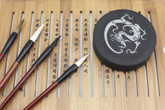 Brush and Chinese characters Royalty Free Stock Photos