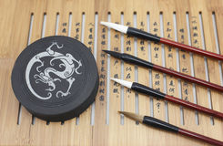 Brush and Chinese characters Royalty Free Stock Photo