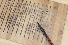 Brush and Chinese characters Royalty Free Stock Image