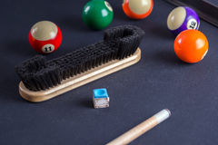 Brush for cleaning of billiard table with cue and balls. Brush for cleaning of billiard table with cue and some balls stock photography