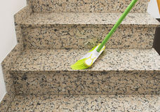 Cleaning the marble stairs with brush Royalty Free Stock Images