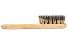 Brush for cleaning shoes with bristles on isolated white background Stock Images