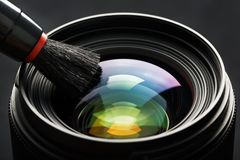 Free Brush Cleaning The Camera Lens With A Beautiful Close-up Optical Unit Stock Image - 167969211