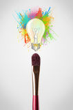 Brush close-up with colored paint splashes and lightbulb. Paintbrush close-up with colored paint splashes and lightbulb concept Stock Photos