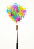 Brush close-up with colored paint splashes Stock Photo