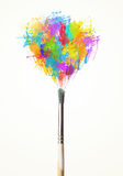 Brush close-up with colored paint splashes Royalty Free Stock Photography