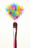 Brush close-up with colored paint splashes. Paintbrush close-up with colored paint splashes royalty free stock photos