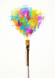 Brush close-up with colored paint splashes. Paintbrush close-up with colored paint splashes Royalty Free Stock Photo
