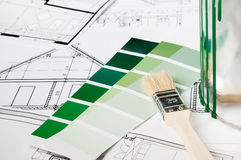 Brush and color for house renovation. Choosing color for house renovation stock image