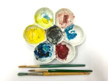 Brush and color wheel. Closeup of brush and color wheel Royalty Free Stock Image