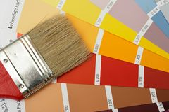 Brush on colorcharts. Paint brush on color chart Stock Images