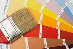 Brush on colorcharts. Paint brush on color chart Stock Photo
