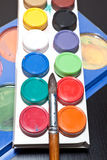 Brush and colored paint artist Stock Images