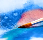 Brush with colorful background Stock Photo