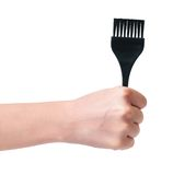Brush for coloring. In a woman hand isolated on white background stock photography